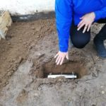 Cllr Weedall placing the time capsule